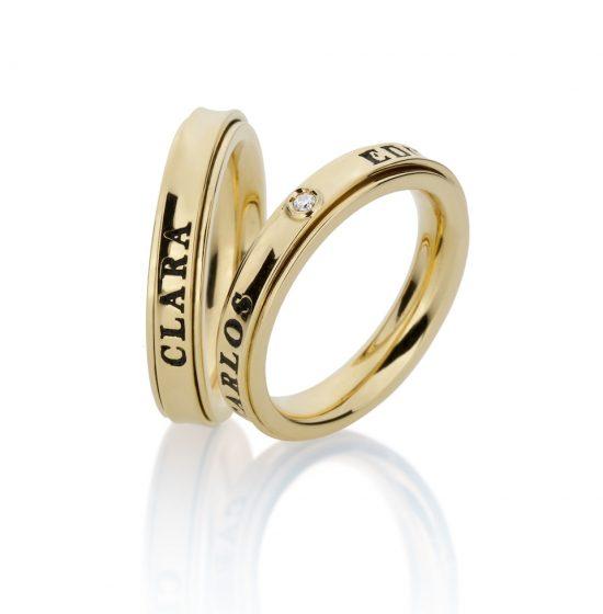 Par Alianças Saturno em ouro 18k, uma com diamantes AA3488
